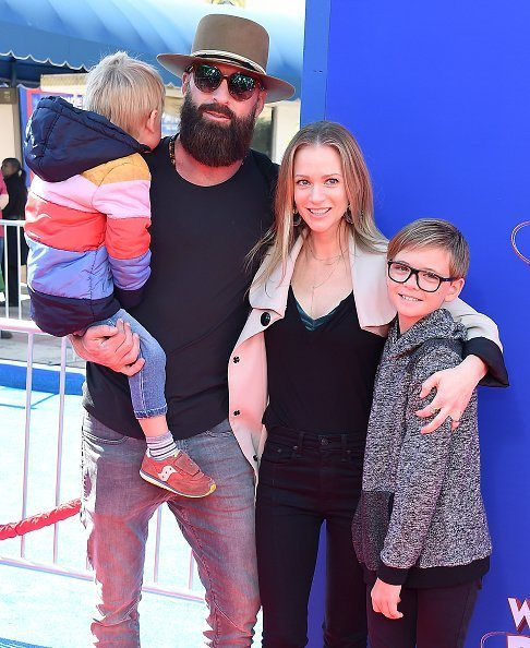 "A.J. Cook, Nathan Andersen, Phoenix Sky Andersen, and Mekhai Allan Andersen attend the Premiere Of Paramount Pictures' ""Wonder Park on March 10, 2019 