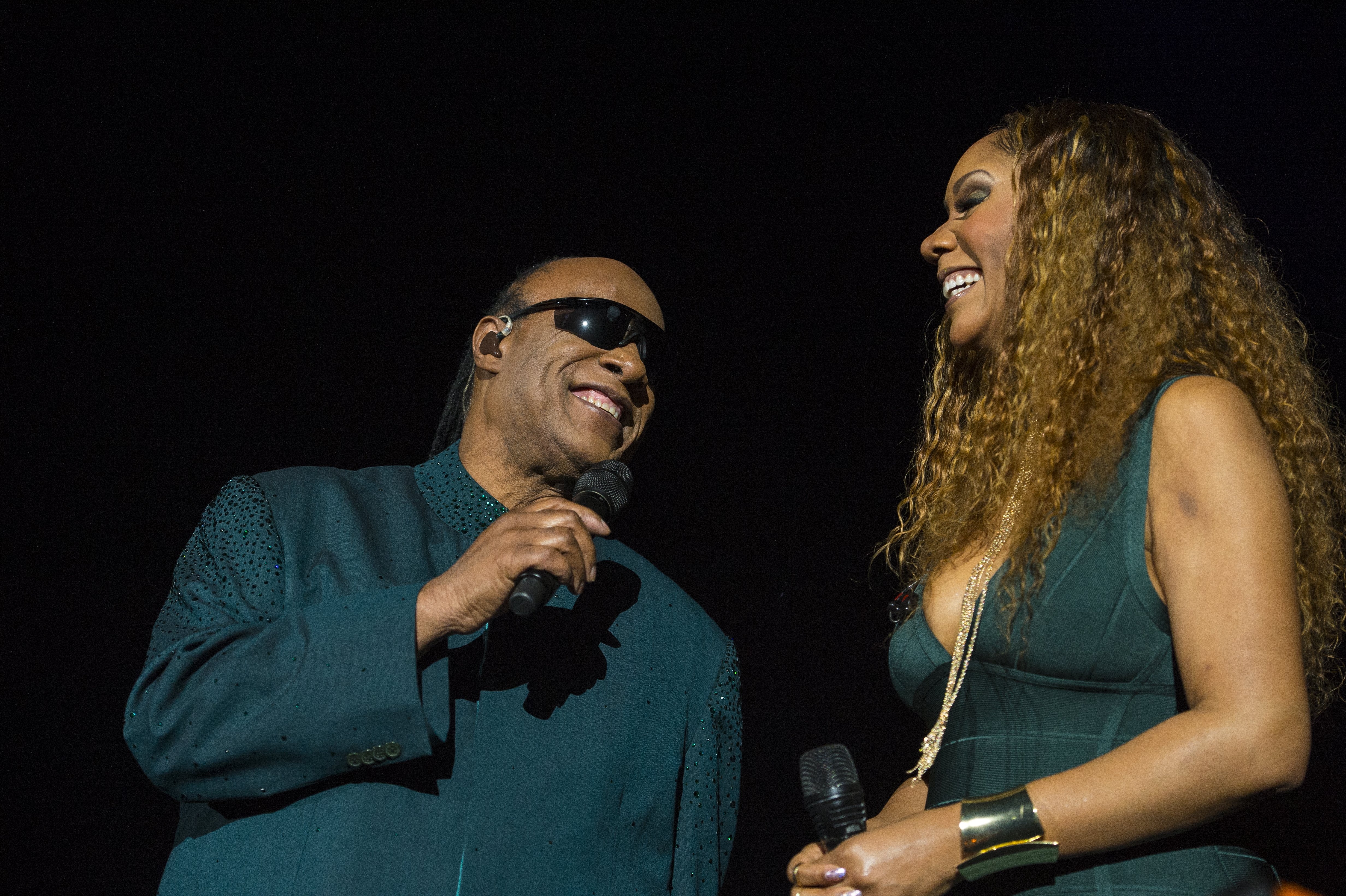 Stevie Wonder with his daughter Aisha Morris at the Pepsi Center on March 17, 2015 | Photo: Getty Images