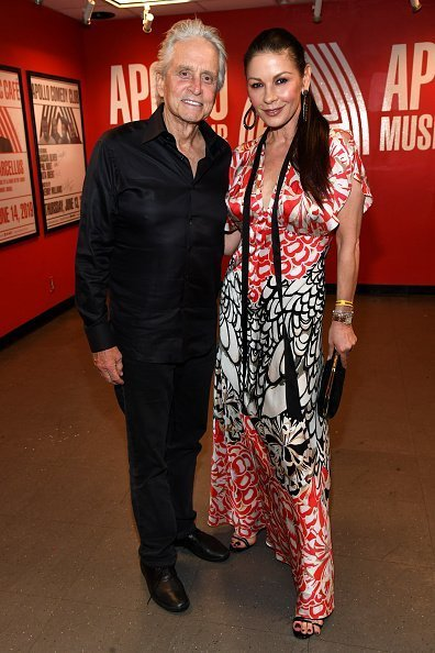 Michael Douglas (L) and Catherine Zeta-Jones attend SiriusXM + Pandora Present Lady Gaga At The Apollo | Photo: Getty Images