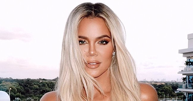 Khloé Kardashian from KUWTK Puts Her Toned Legs on Display in Form-Fitting Jeans & Chic White Top
