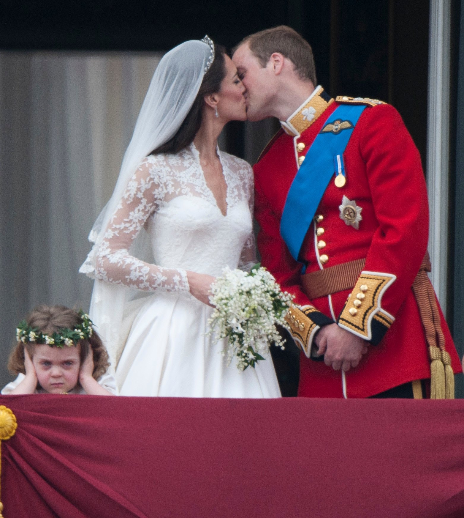 Kate Middleton and Prince William on the balcony at Buckingham Palace with bridesmaid Grace Van Cutsem, on April 29, 2011 in London, England | Photo: Getty Images