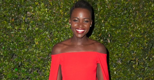 'Black Panther' Star Lupita Nyong'o Is All Smiles Smiles in a Green Outfit with a Floral Crown