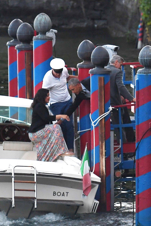 Barack Obama disembarking a boat at Lake Como   Photo: Hollywood Life