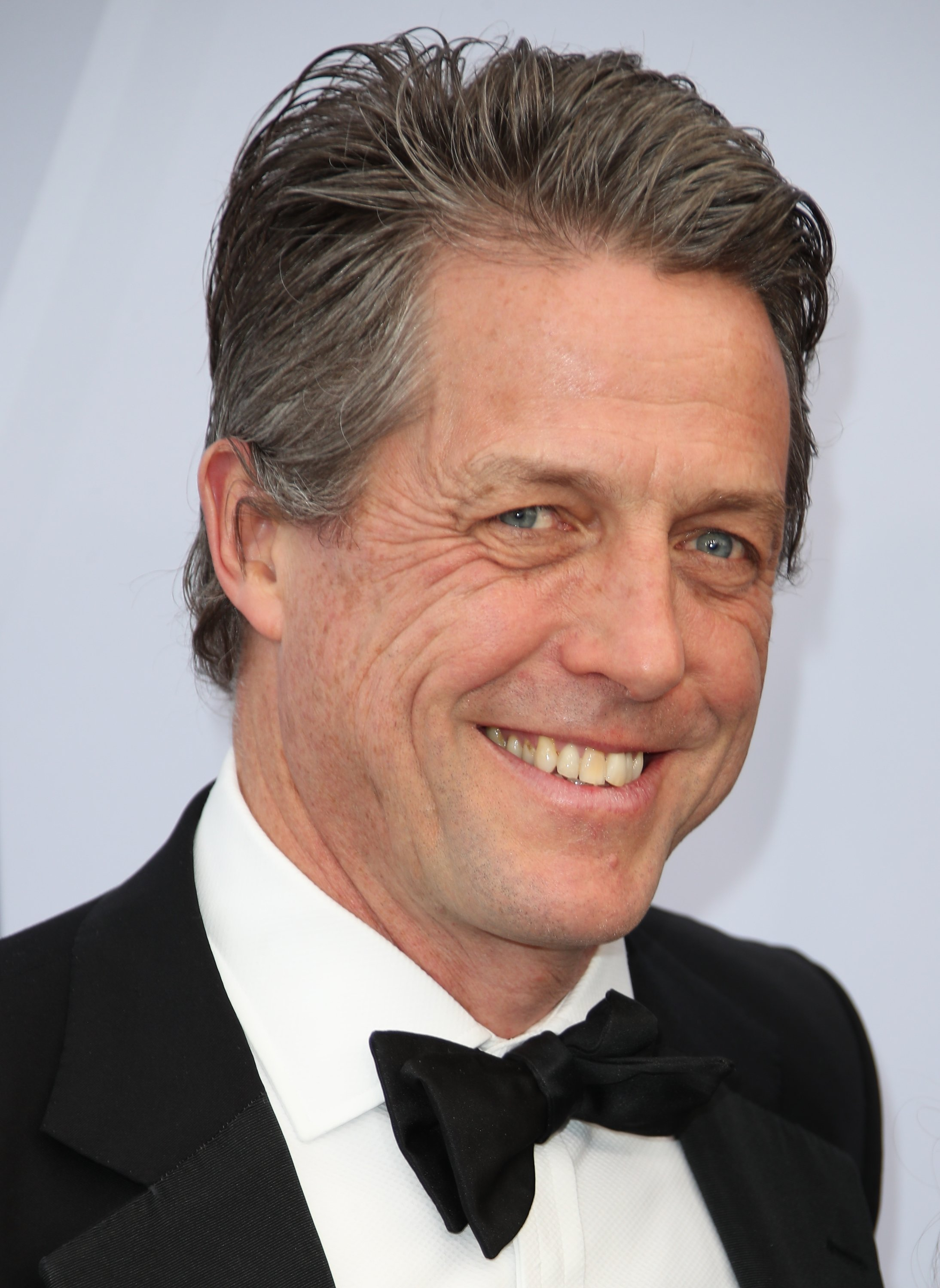 Hugh Grant attending the 25th Annual Screen Actors Guild Awards | Photo: Getty Images