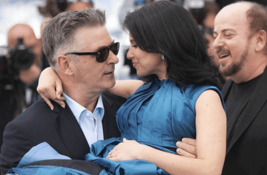 "Alec Baldwin carries his wife, Hilaria Baldwin in his arms as they attend the photocall for ""Seduced and Abandoned"" at the 66th Annual Cannes Film Festival, on May 21, 2013 in Cannes, France 