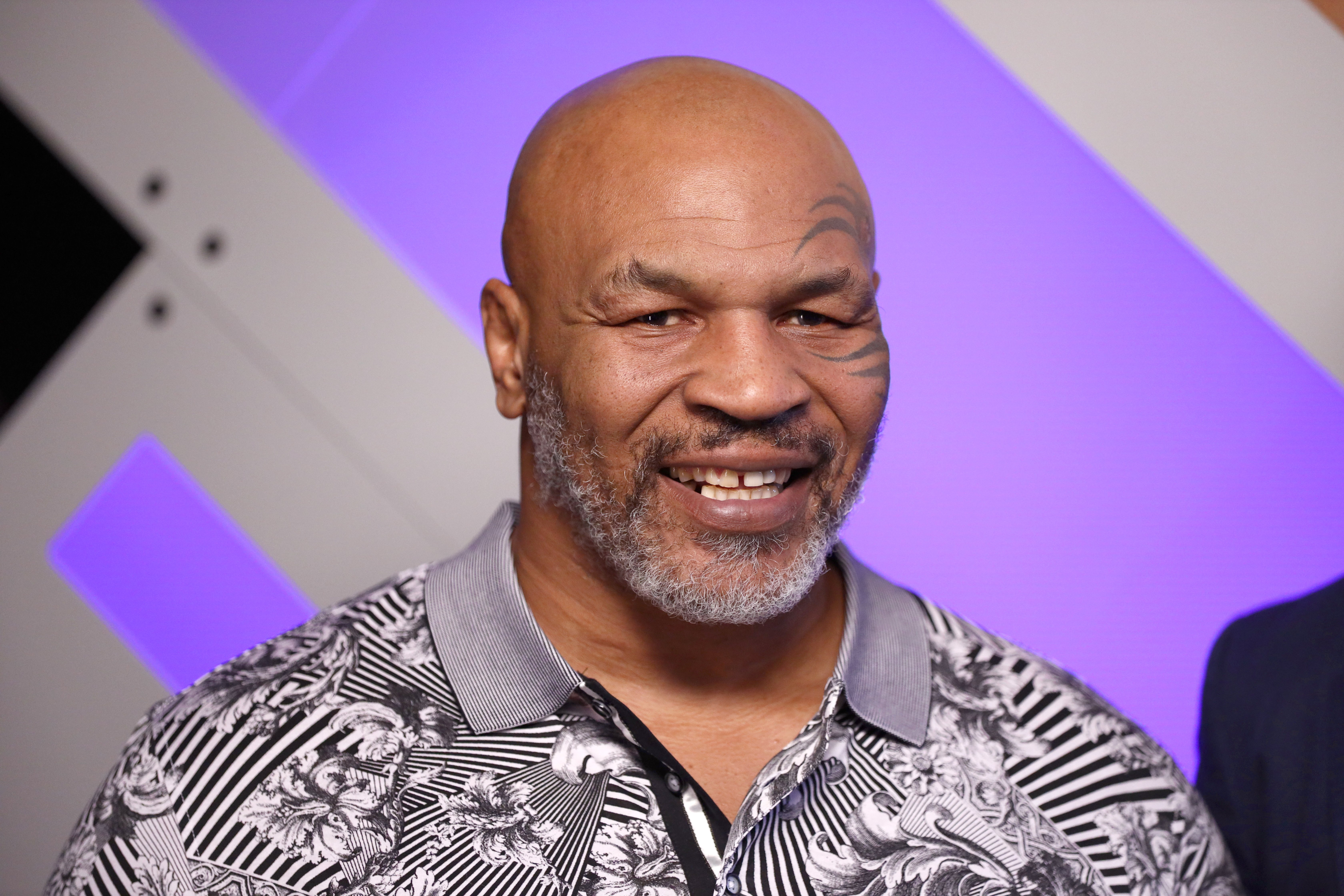 Mike Tyson speaks with Mario Lopez at Capital One Podcast Studio during the 2019 iHeartRadio Podcast Awards Presented by Capital One at the iHeartRadio Theater LA on January 18, 2019, in Burbank, California. | Source: Getty Images.