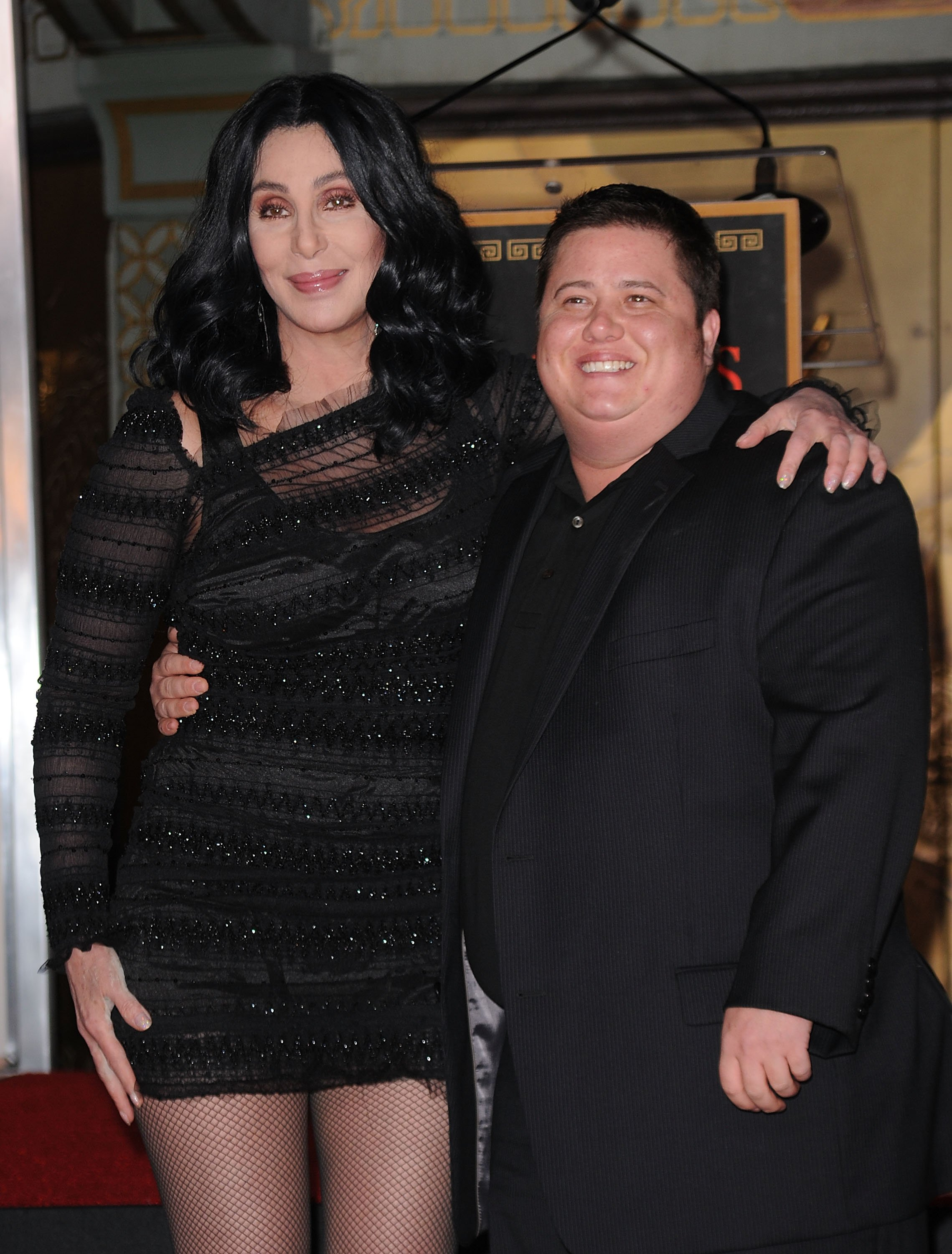 Cher and Chaz Bono pose as Cher is immortalized with hand and footprint ceremony at Grauman's Chinese Theatre on November 18, 2010 | Photo: GettyImages
