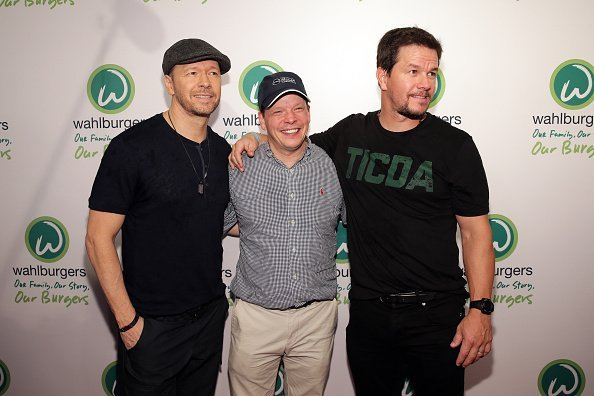 Donnie Wahlberg, Paul Wahlberg and Mark Wahlberg attend the Wahlburgers Coney Island Preview Party on June 23, 2015, in the Brooklyn Borough of New York City. | Source: Getty Images.