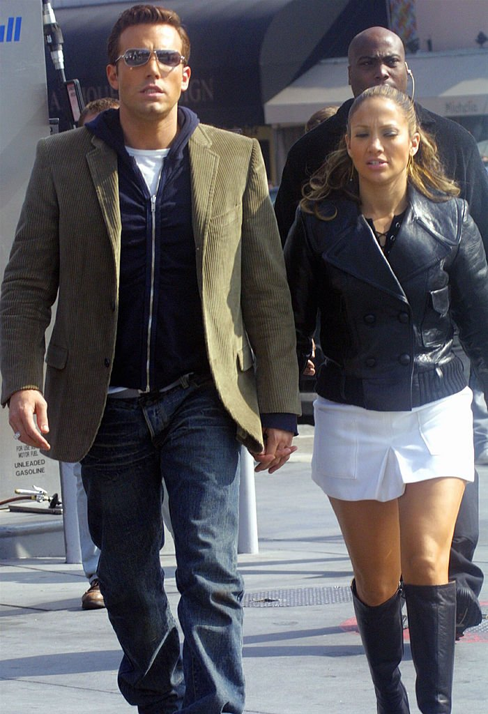Jennifer Lopez and actor Ben Affleck hold hands while filming her new music video at Barefoot restaurant on October 20, 2002 in Beverly Hills, California. | Source: Getty Images