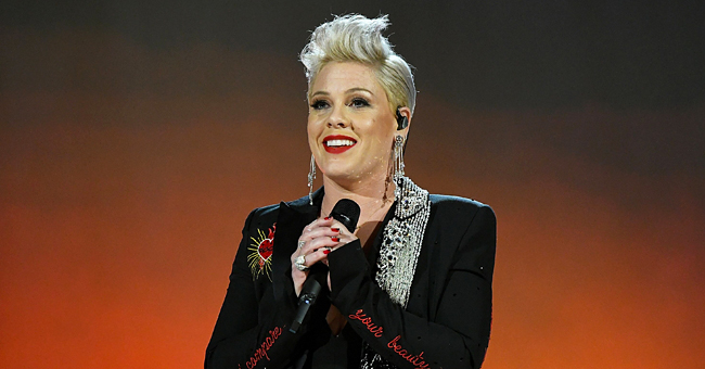 Pink Fan Responds to Comments after Being Criticized for Giving Birth during a Concert