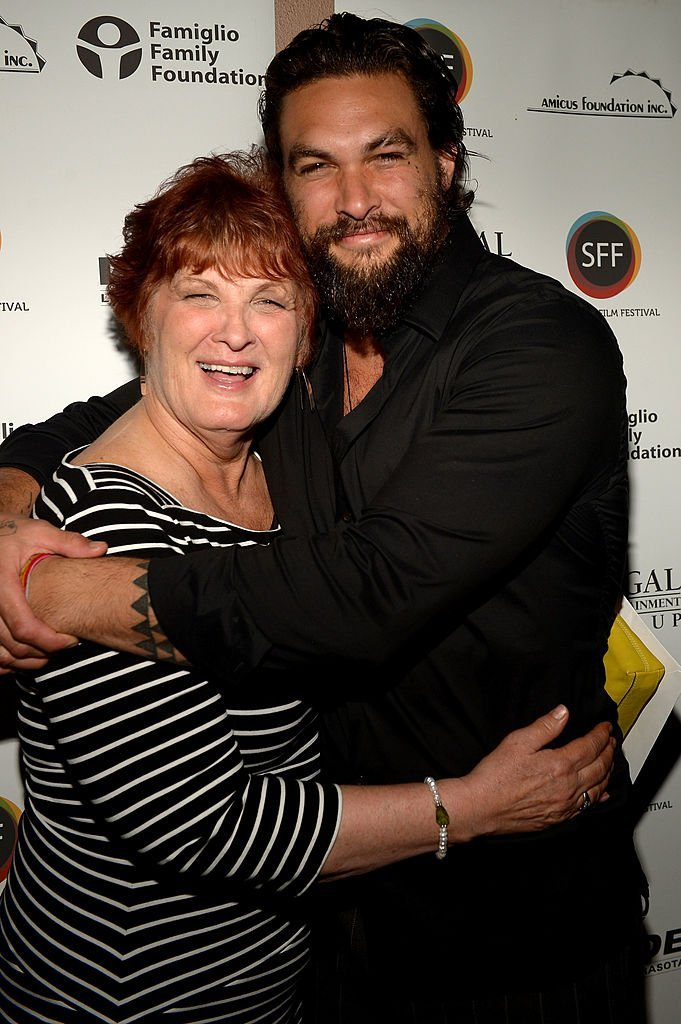Jason Momoa (R) and his mother Coni Momoa arrive to a screening of 'Road to Paloma' during the Sarasota Film Festival | Getty Images