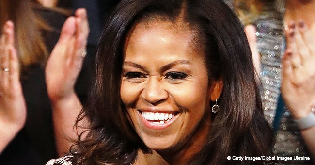 Michelle Obama flaunts her natural curly hair while rocking striped dress during Spain vacation