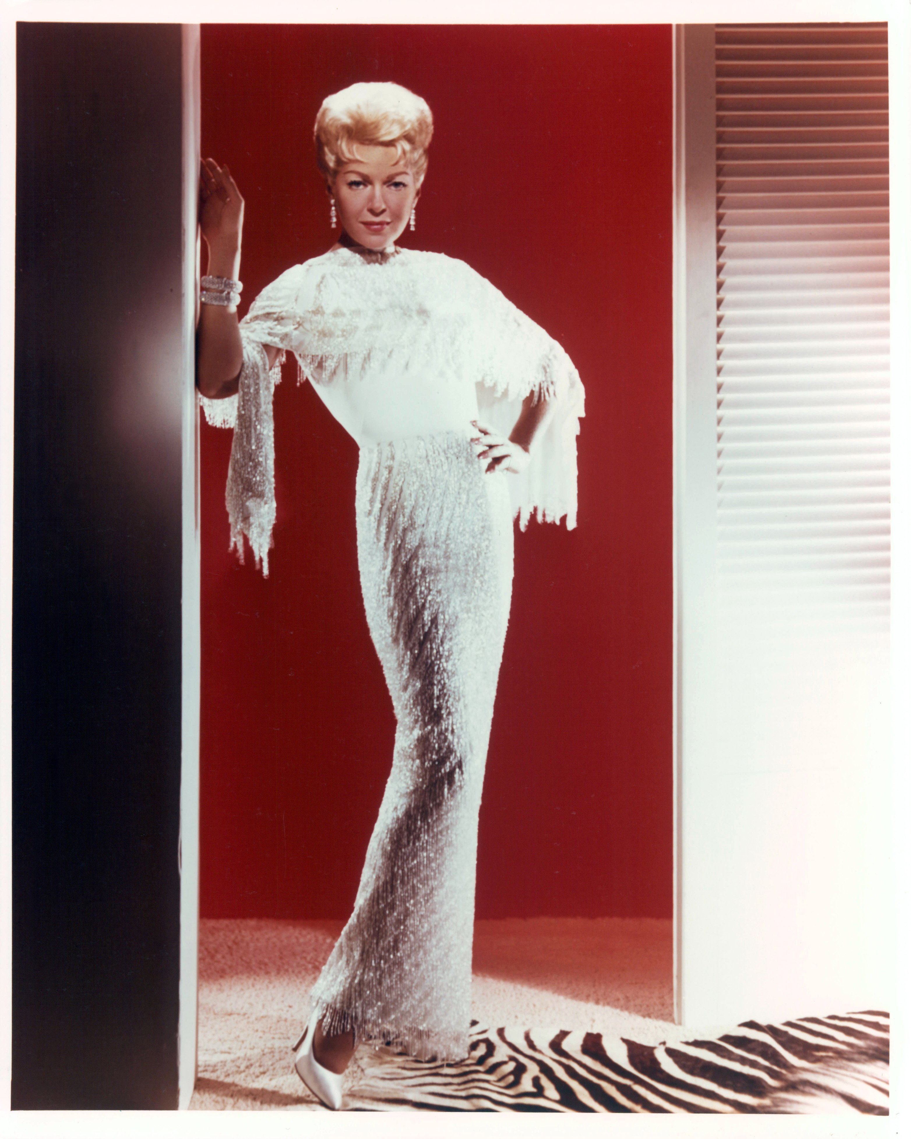 Lana Turner stands in a doorway in publicity portrait for the film 'Love Has Many Faces', 1965. | Source: Getty Images