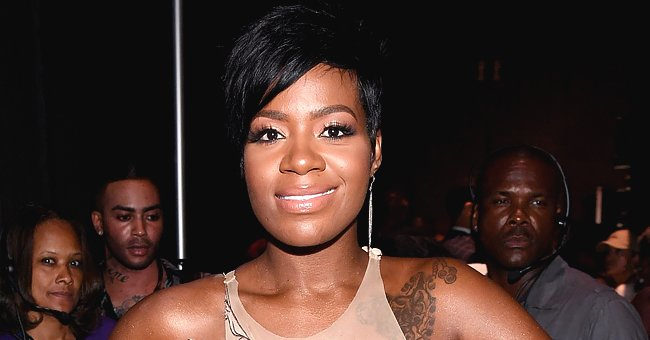 Fantasia Looks Gorgeous in a White Outfit & Huge Jewelry While Posing in a New Photo