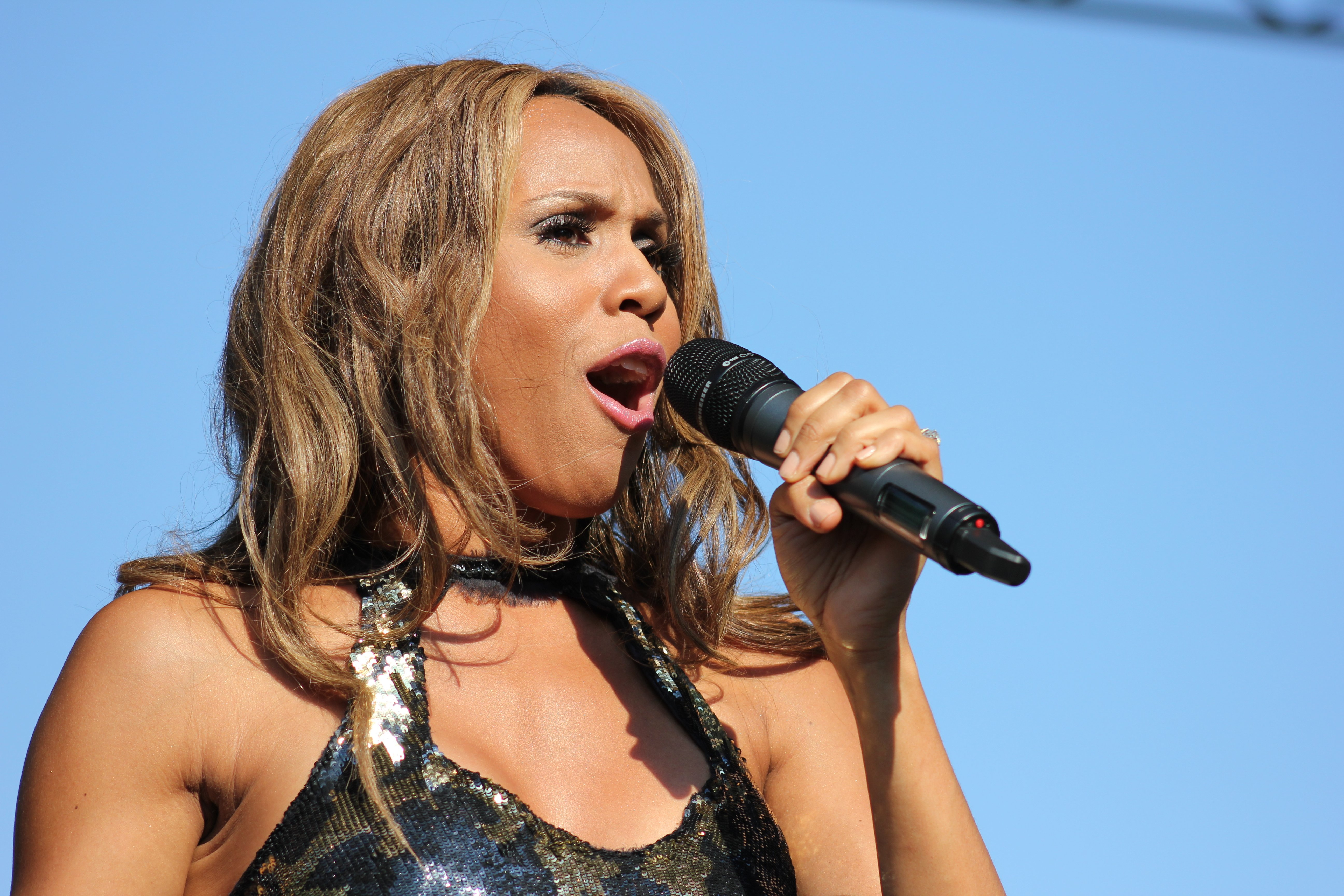 Deborah Cox performing during the 37th Capital Pride Festival at the Main Stage on Pennyslvania Avenue and 3rd Street, NW, Washington DC on June 10, 2012| Photo: Wkimedia Commons