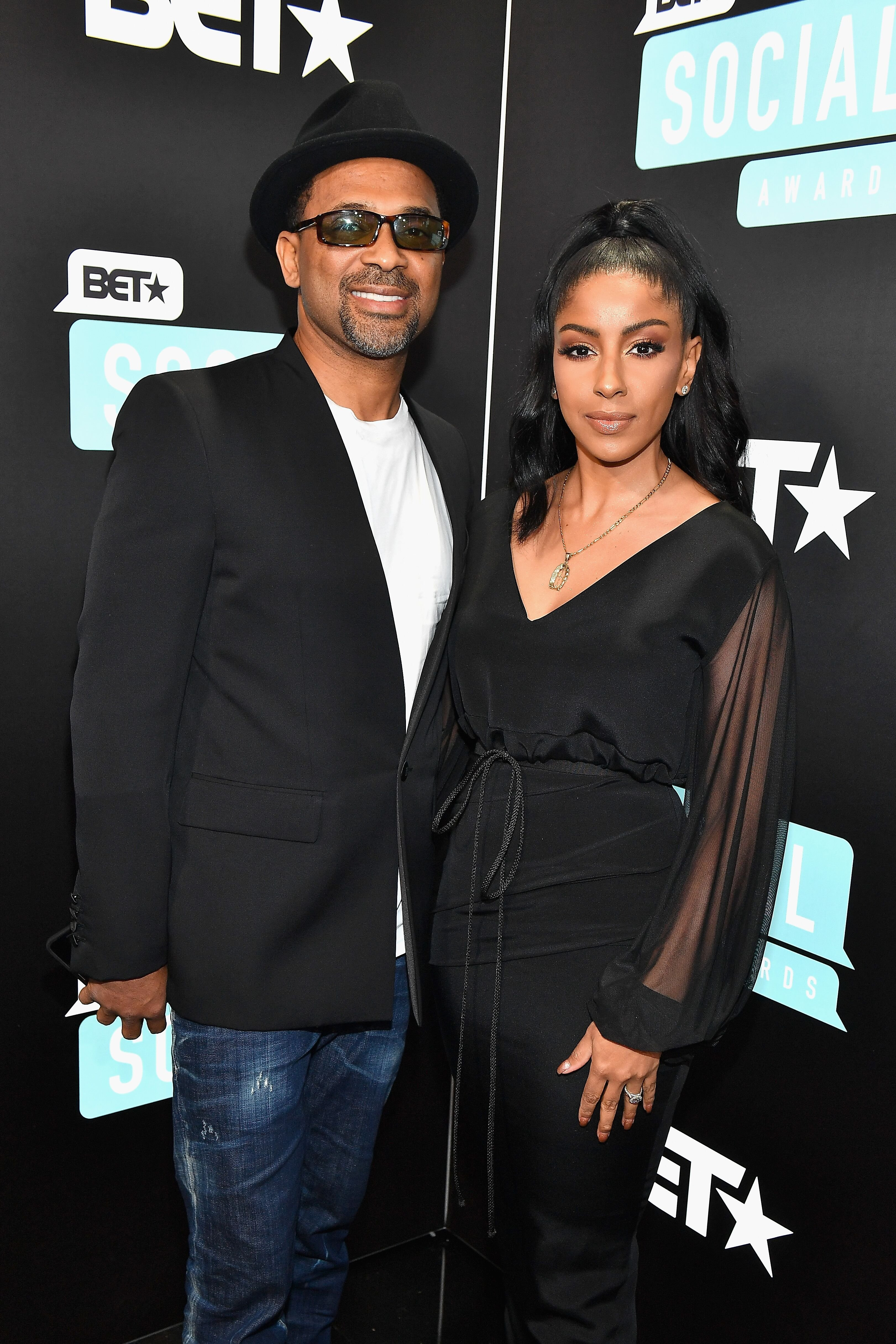 Mike Epps and Kyra Robinson attend the 2019 BET Social Awards at Tyler Perry Studio on March 3, 2019 in Atlanta, Georgia.   Source: Getty Images