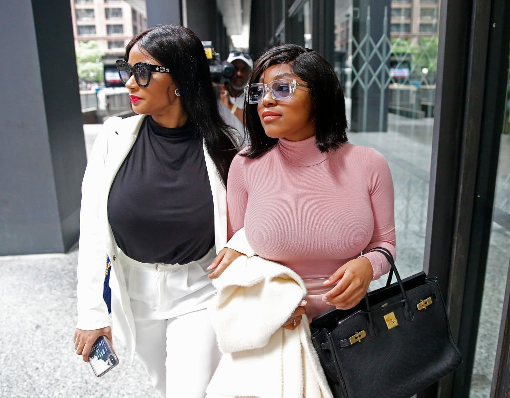 Azriel Clary and Joycelyn Savage, leave after the singer's arraignment at the Dirksen Federal Building on July 16, 2019. | Photo: GettyImages
