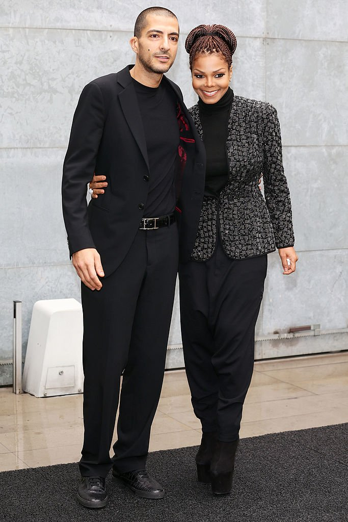 Wissam Al Mana and Janet Jackson at the Giorgio Armani fashion show on February 25, 2013, in Milan | Photo: Getty Images