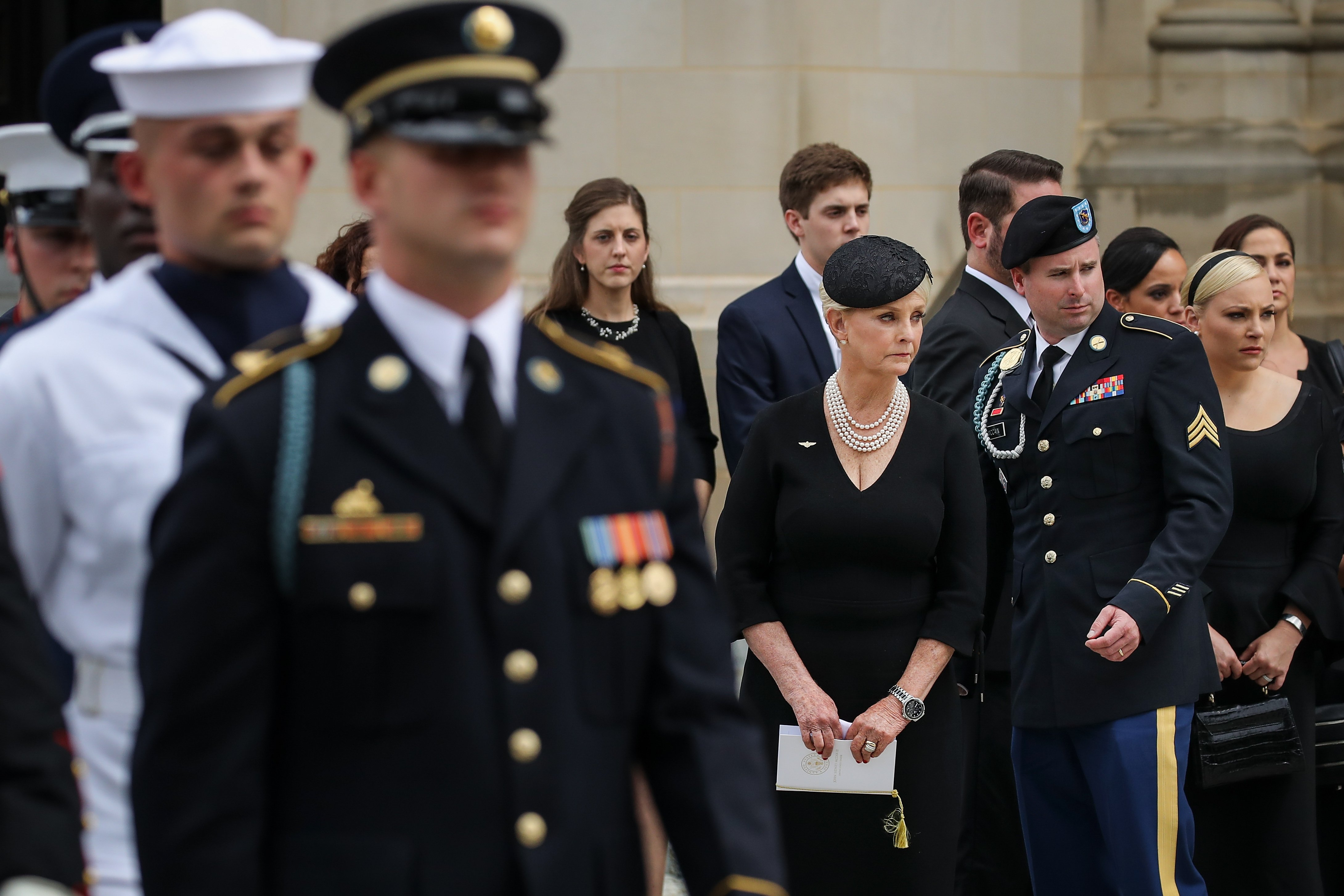Cindy, James, and Meghan McCain look on as the casket of the late Senator John McCain is loaded into a Hearse at the Washington National Cathedral, September 1, 2018 in Washington, DC | Photo: Getty Images