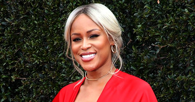 Rapper Eve Posts FBF Photo Posing Next to Her Millionaire Husband in Front of a Lavish Pink Car