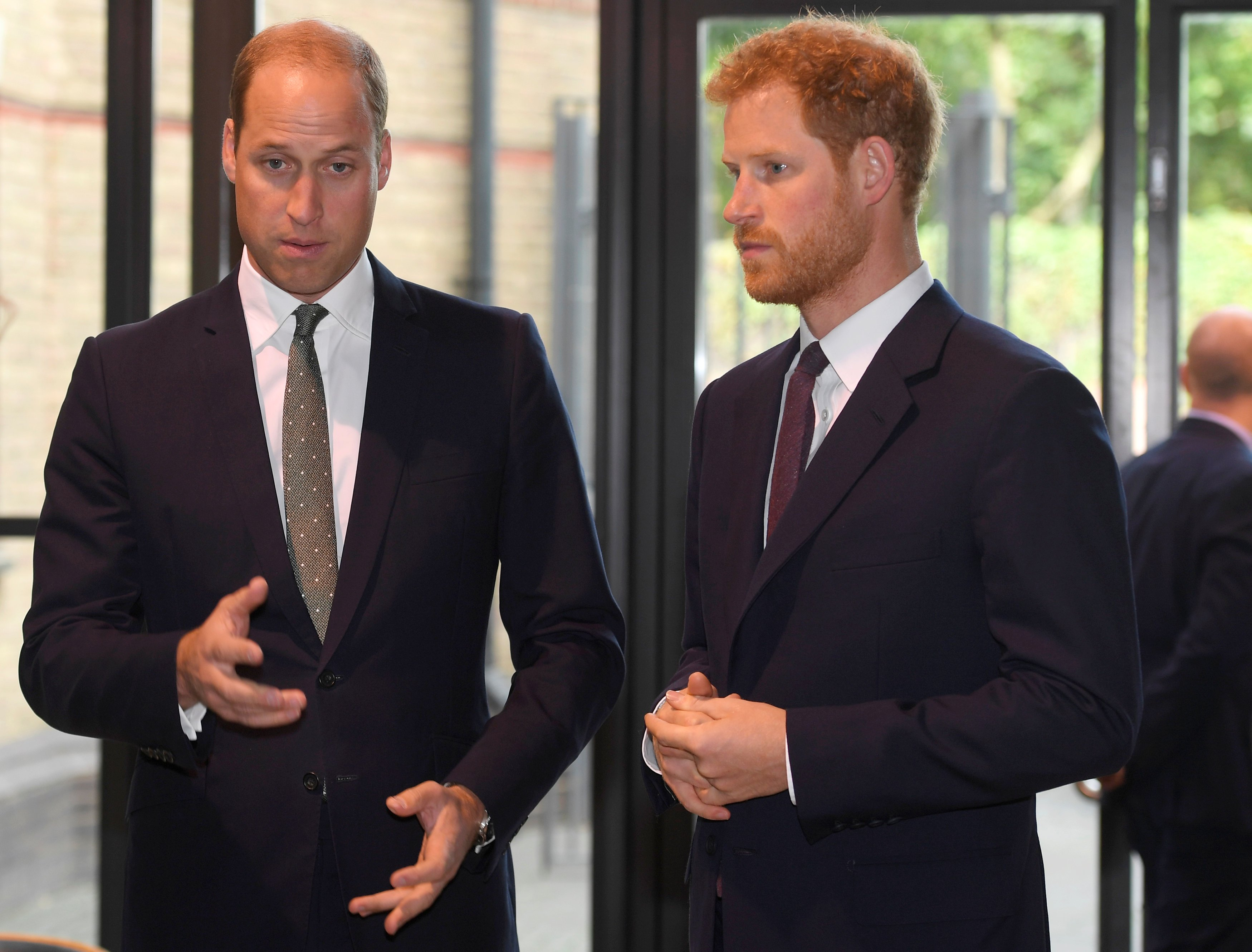 "Prince William, Duke of Cambridge and Prince Harry arrive during a visit to the Royal Foundation ""Support4Grenfell"" community hub on September 5, 2017. 