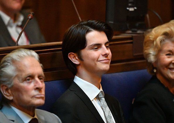 Dylan Douglas watches his mother Catherine Zeta-Jones at the Guildhall, Swansea, during a ceremony where she will was honoured by her home city with the Honorary Freedom of the City and County of Swansea | Photo: Getty Images