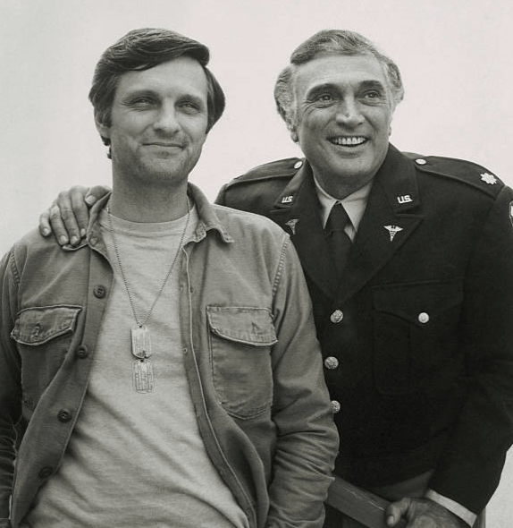 1974: Alan and Robert Alda on the set of M*A*S*H*. Image Credit: Getty Images