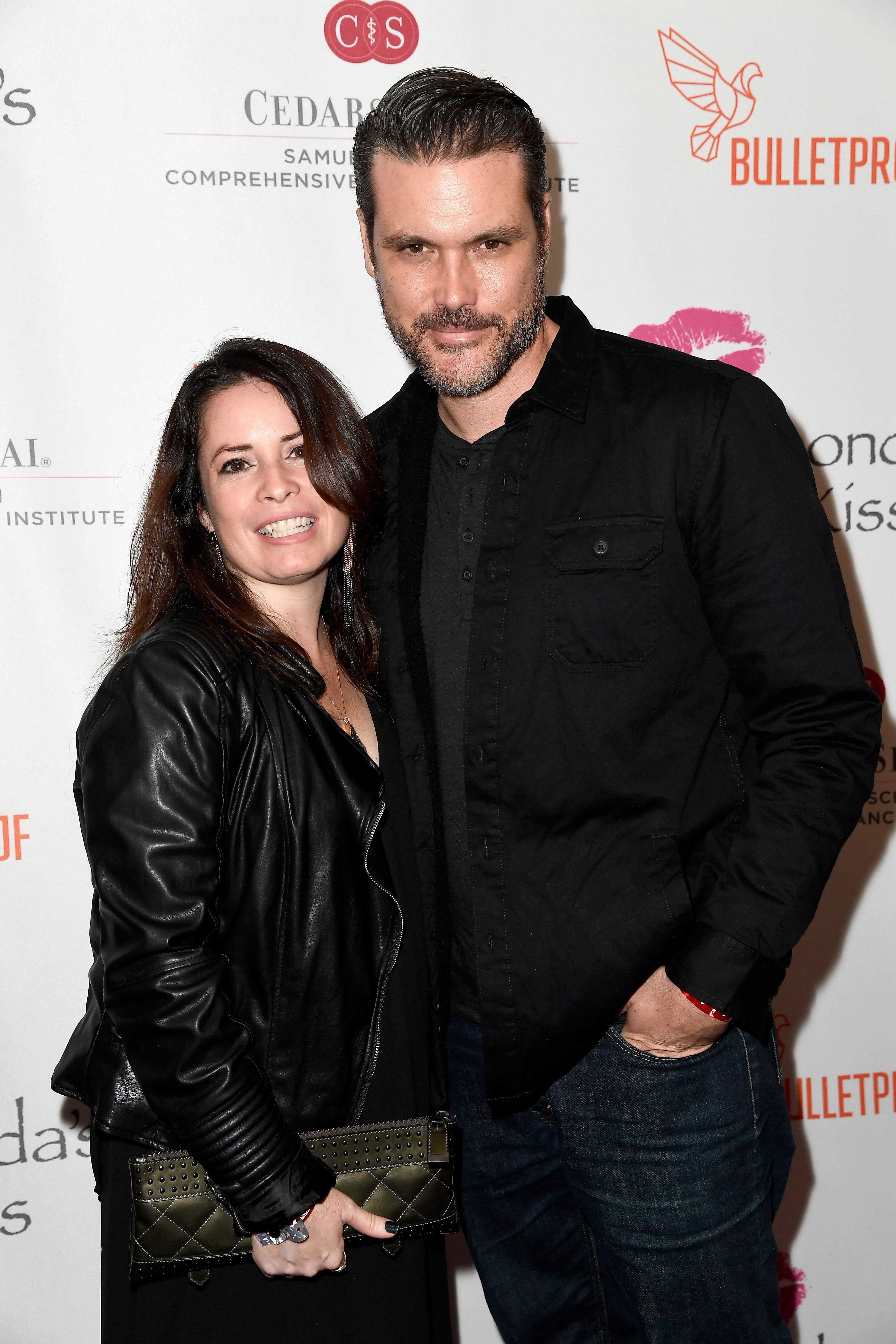 Holly Marie Combs and Mike Ryan at the 2016 Rhonda's Kiss Benefit in Los Angeles, California | Source: Getty Images
