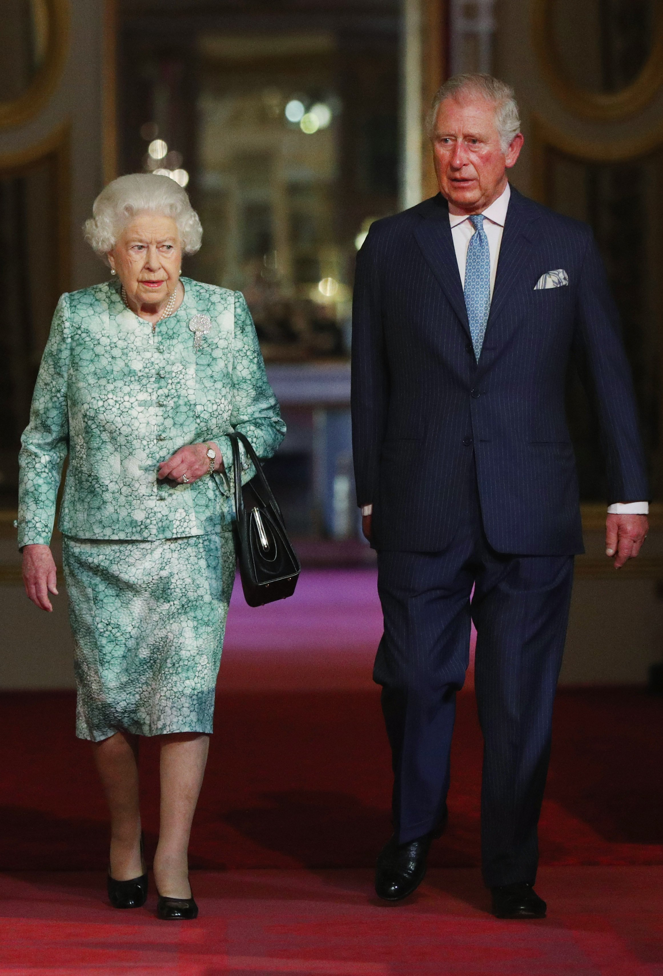 Queen Elizabeth II and Prince Charles, Prince of Wales attend the formal opening of the Commonwealth Heads of Government Meeting on April 19, 2018, in London, England. | Source: Getty Images.