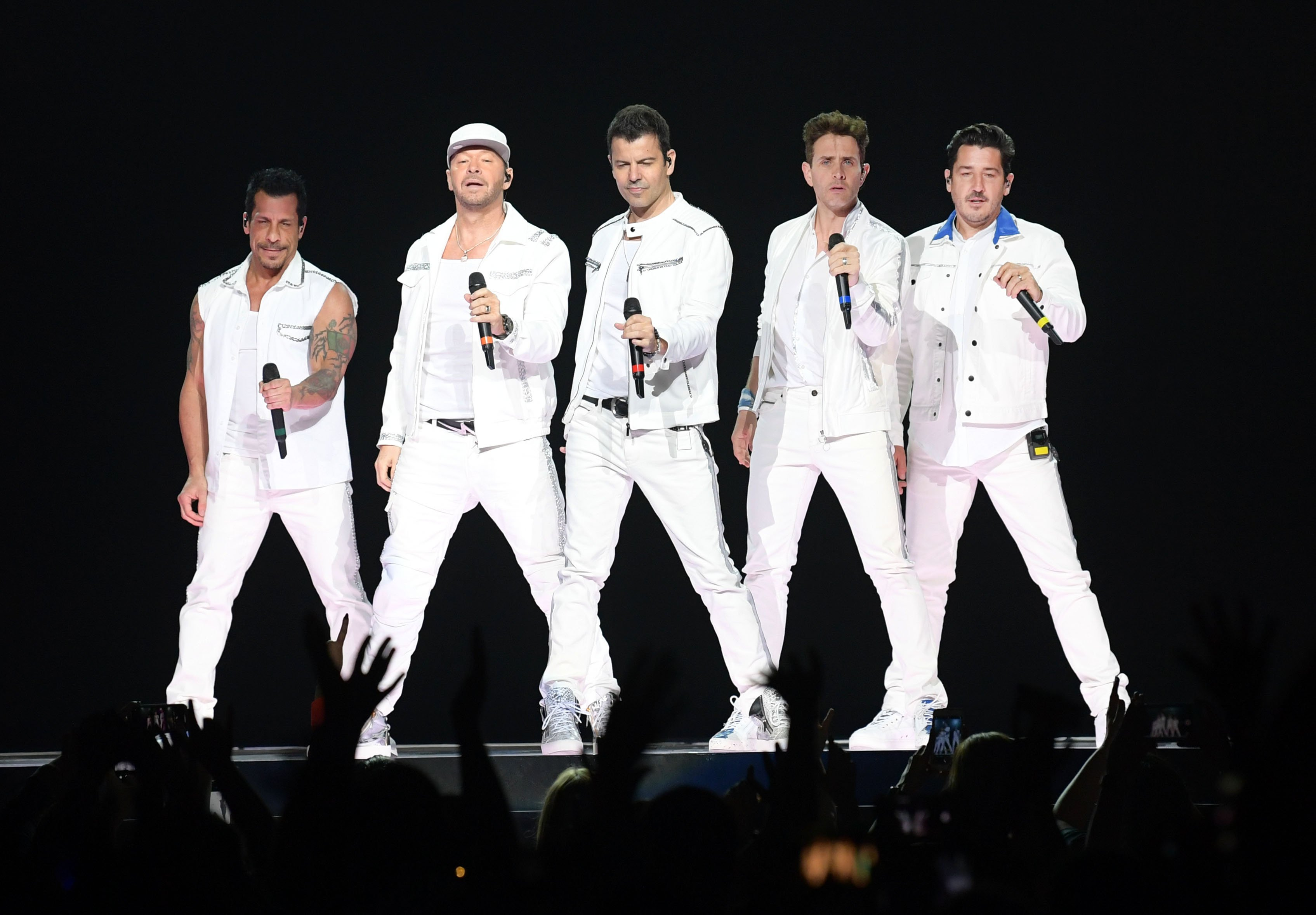 Danny Wood, Donnie Wahlberg, Jordan Knight, Joey McIntyre and Jonathan Knight of the musical group New Kids On The Block perform at Bridgestone Arena on May 09, 2019, in Nashville, Tennessee. | Source: Getty Images.