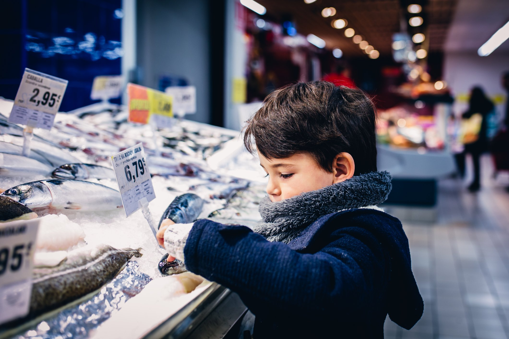 Boy observing goods in store  Photo: Getty Images