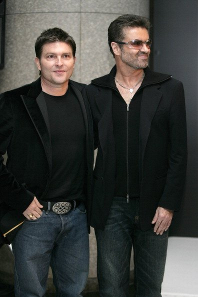 George Michael and Kenny Goss on December 15, 2005 at Cafe Les Deux Magots Paris in Tokyo, Japan.   Photo: Getty Images