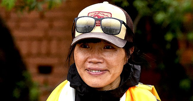 Hong Kong teacher Tsang Yin-hung, the fastest female Everest climber, pictured wearing a cap and yellow raincoat.   Photo: Getty Images