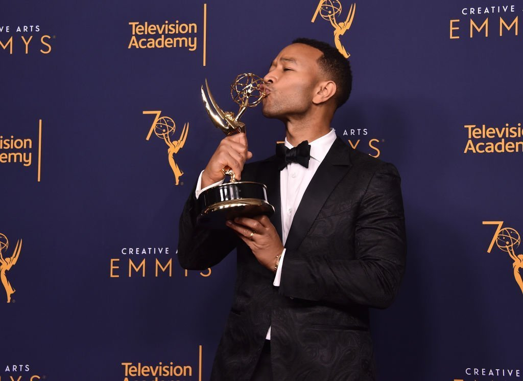 John Legend poses in the press room during the 2018 Creative Arts Emmys at Microsoft Theater on September 9, 2018, in Los Angeles, California. | Source: Getty Images.