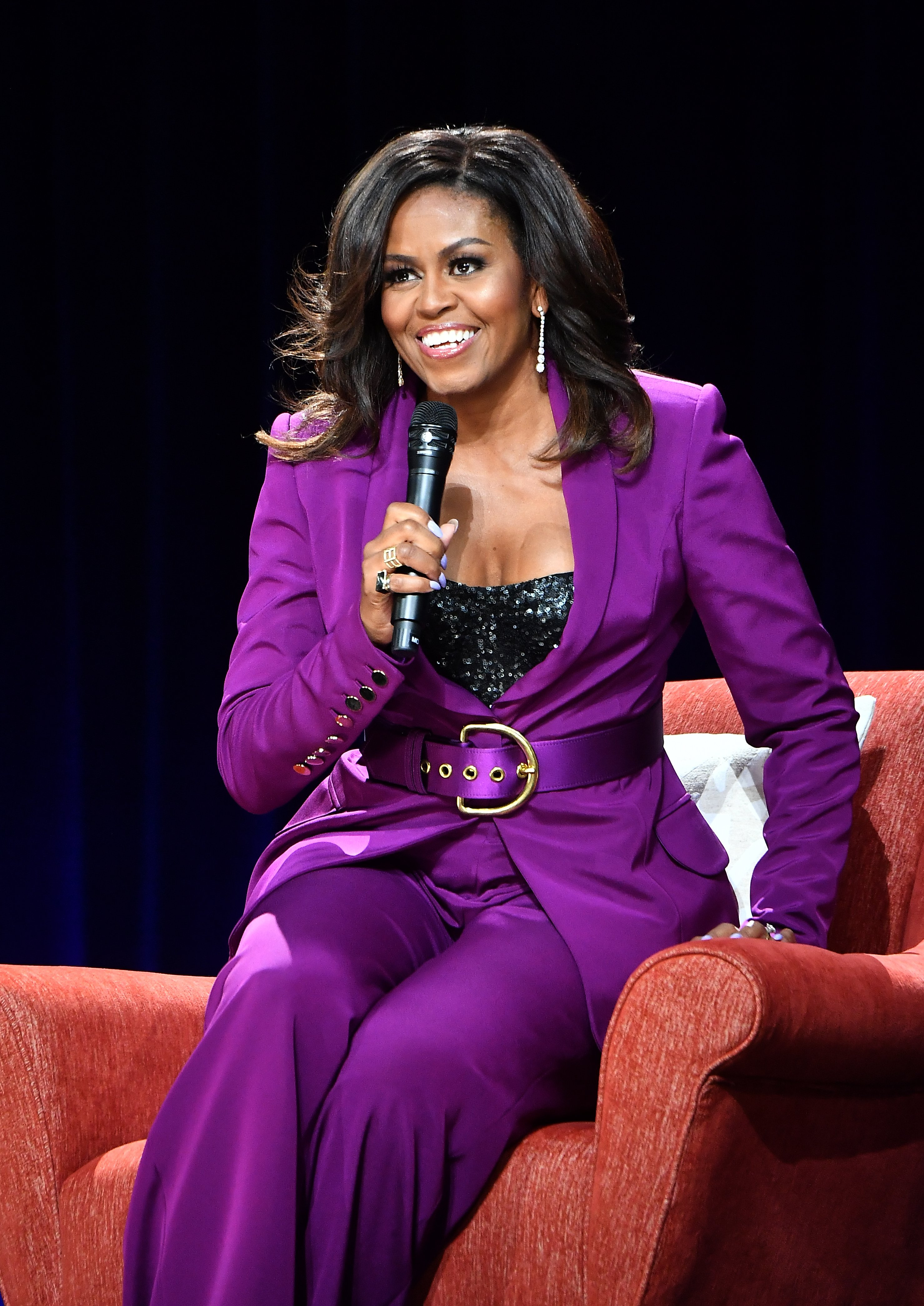 Former First Lady Michelle Obama attends 'Becoming: An Intimate Conversation with Michelle Obama' at State Farm Arena on May 11, 2019, in Atlanta, Georgia.   Source: Getty Images.