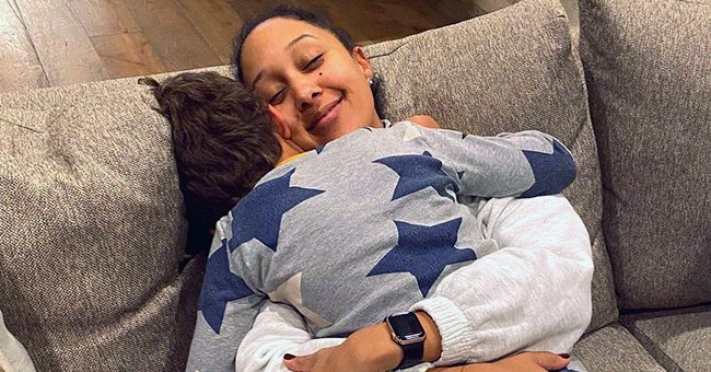 Tamera Mowry's Son Aden Looks Handsome While Playing with Their Dog Chloe in This Candid Shot