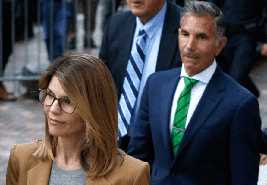 Lori Loughlin and her husband, Mossimo Giannulli as they leave the John Joseph Moakley United States Courthouse, on April 3, 2019, Boston | Source: Jessica Rinaldi/The Boston Globe via Getty Images