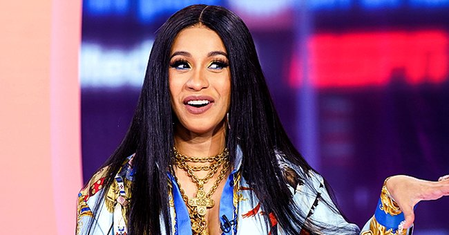 Cardi B Flaunts Her Toned Legs as She Steps Out in a White Chanel Shirt & Trendy Handbag