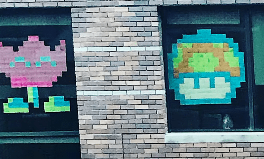 Creative Post-it note art that was used to communicate from one building to another | Photo: Youtube/Good Morning America
