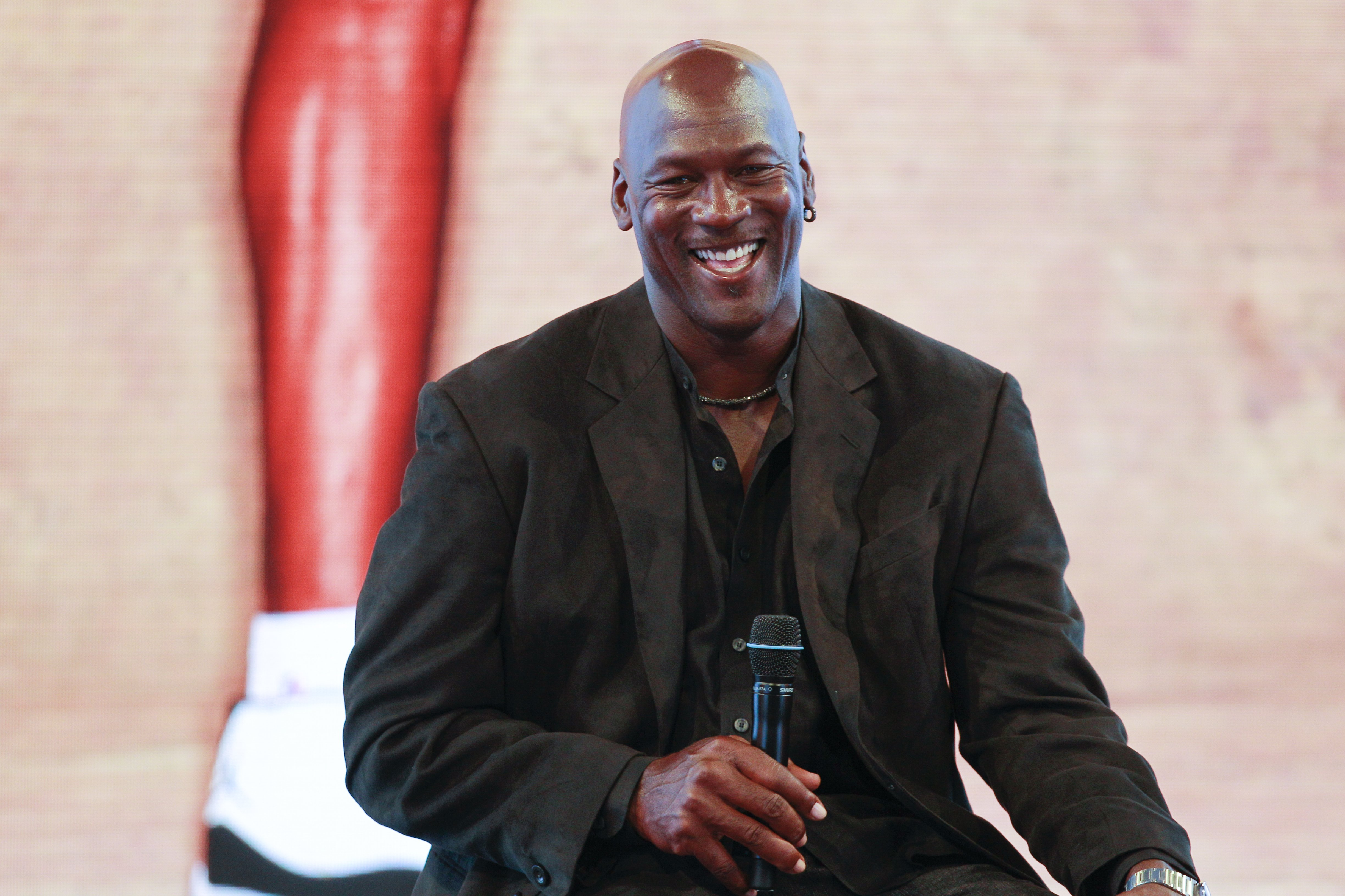 Michael Jordan attends a press conference for the celebration of the 30th anniversary of the Air Jordan Shoe during the 'Palais 23' interactive exhibition dedicated to Michael Jordan at Palais de Tokyo in Paris on June 12, 2015 | Photo: GettyImages