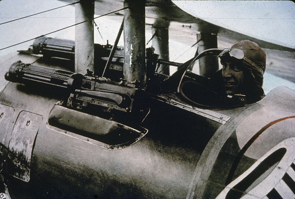 Rickenbacker sits in his Nieuport 28 fighter plane and smiles at the camera, 1910s   Source: Getty Images