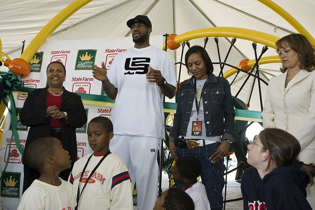 LeBron James and his mother attending a playground dedication in behalf of the LeBron James Family Foundation in February 2008. | Photo: Getty Images