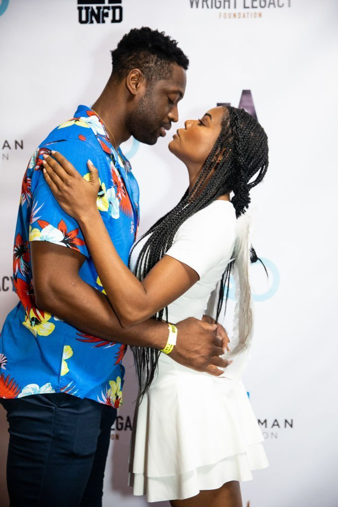 Dwyane Wade (L) and Gabrielle Union (R) pose together at the Wright Legacy Foundation skate night at World | Photo: Getty Images