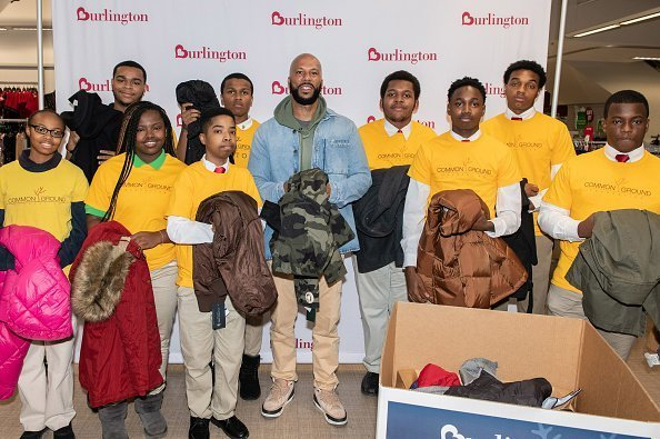 Common and kids from the Common Ground Foundation on November 13, 2019 | Photo: Getty Images