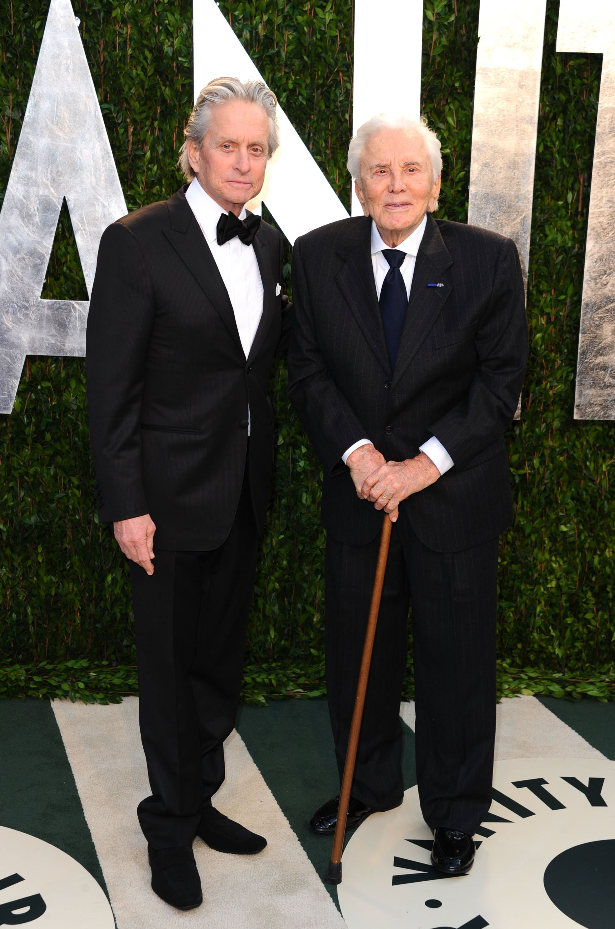 Michael Douglas and Kirk Douglas arrive at the 2012 Vanity Fair Oscar Party at Sunset Tower on February 26, 2012 in West Hollywood, California | Photo: Getty Images