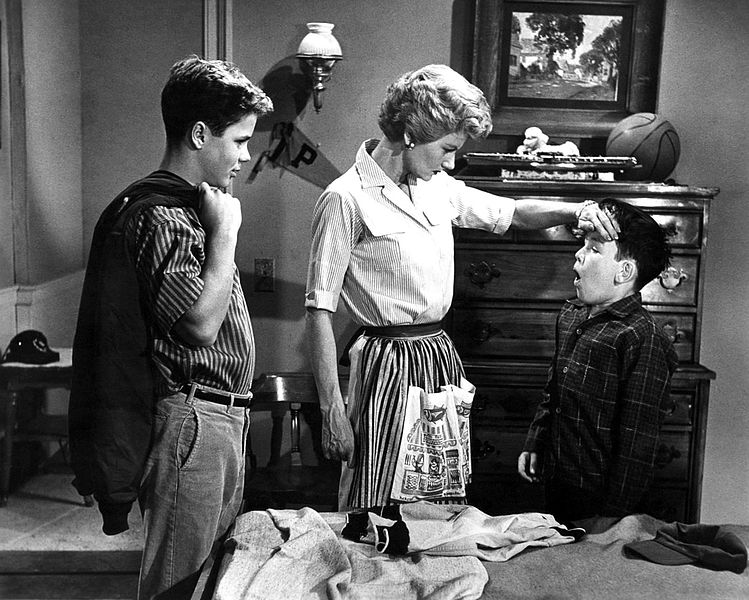 "Photo of a scene from ""Leave it to Beaver"" with Tony Dow, Barbara Billingsley, and Jerry Mathers. 