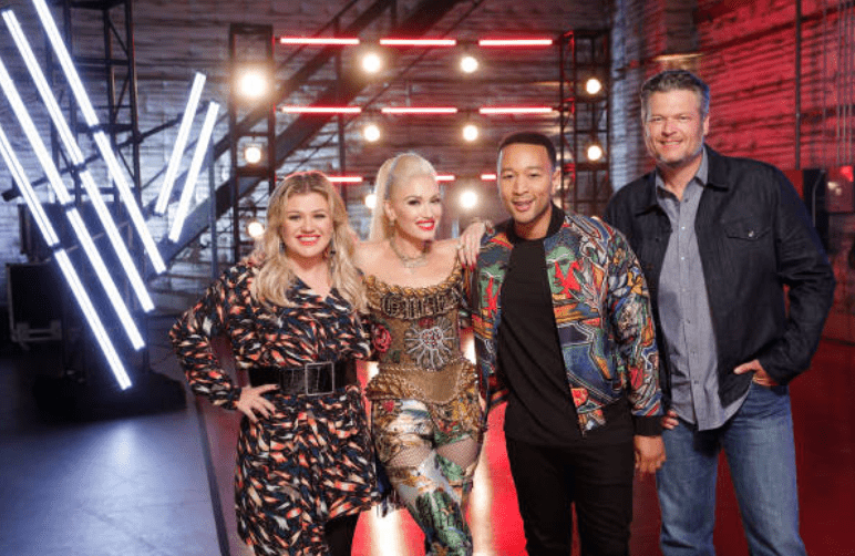 Kelly Clarkson, Gwen Stefani, John Legend and Blake Shelton pose together on stage before filming for the blind auditions | Source: Getty Images (Photo by: Trae Patton/NBCU Photo Bank/NBCUniversal via Getty Images via Getty Images)