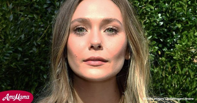Elizabeth Olsen, 29, flashes her incredibly tiny waist in tight blue trousers