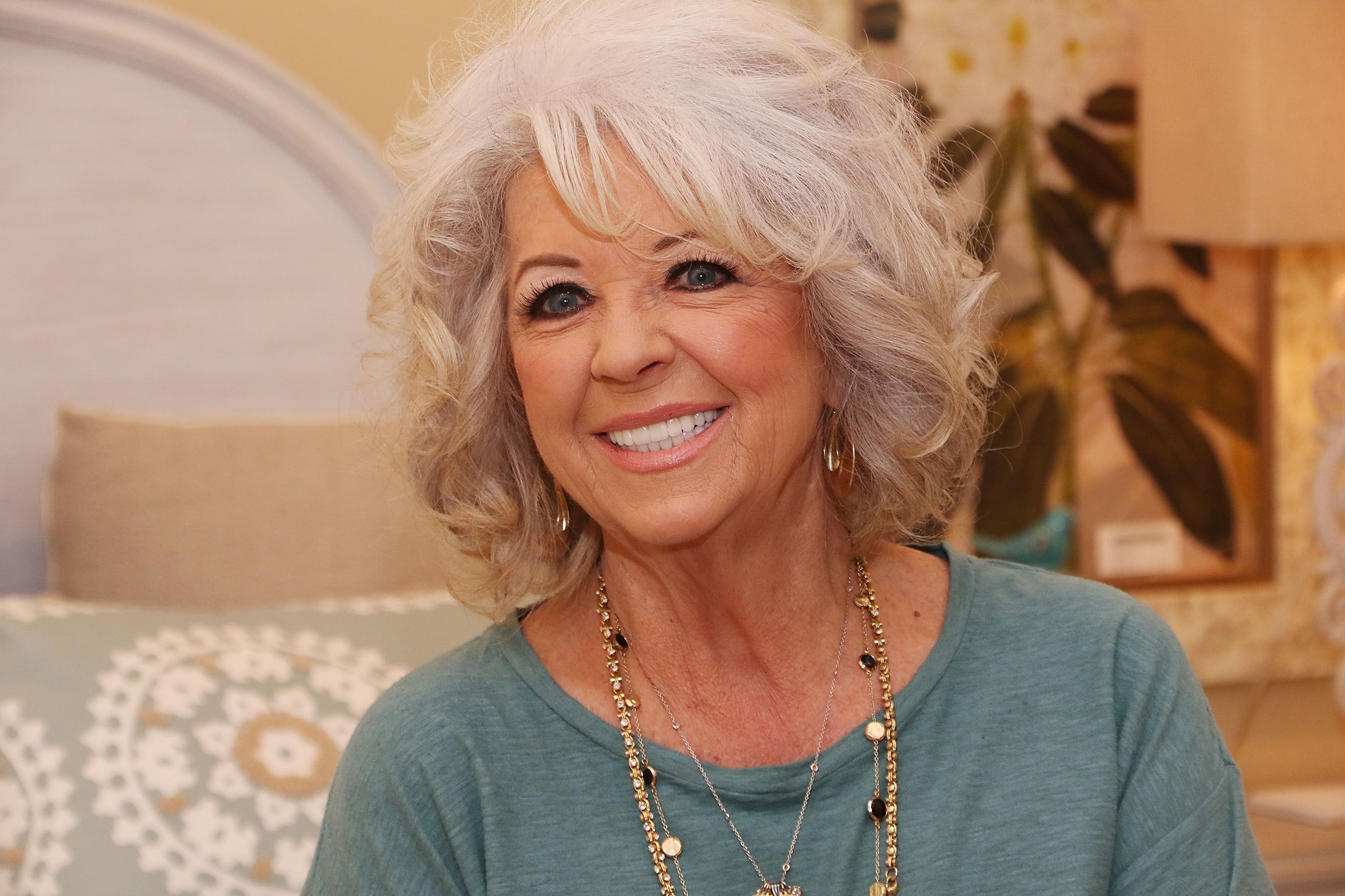 """Paula Deen signs copies of her book """"Cuts the Fat"""" in 2016 in Boca Raton, Florida 