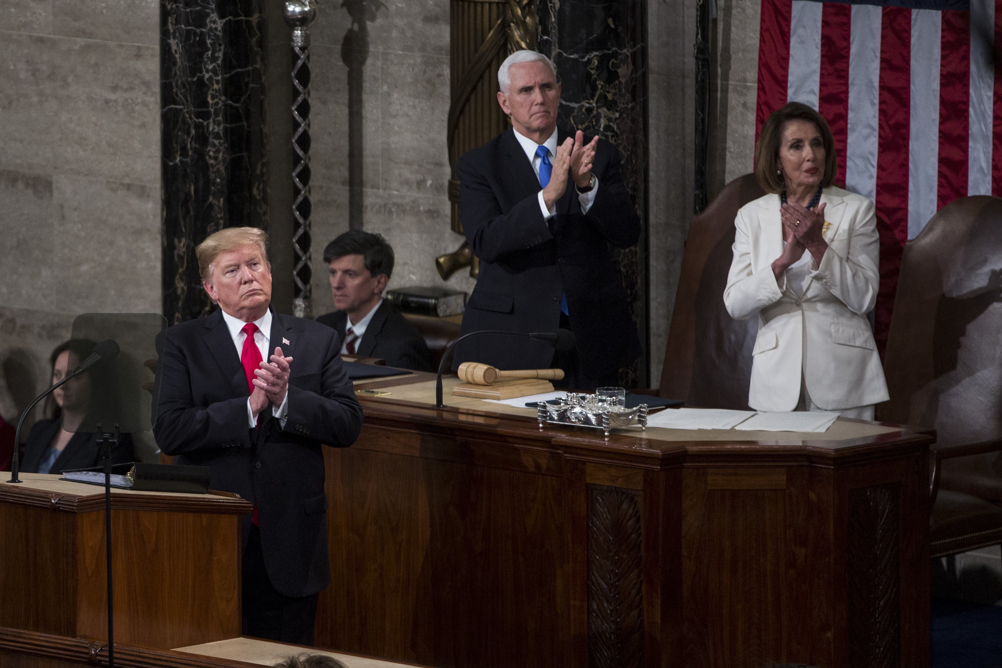 President Trump with Vice President Mike Pence and Speaker of the House Nancy Pelosi applauding Buzz Aldrin | Photo: Getty Images